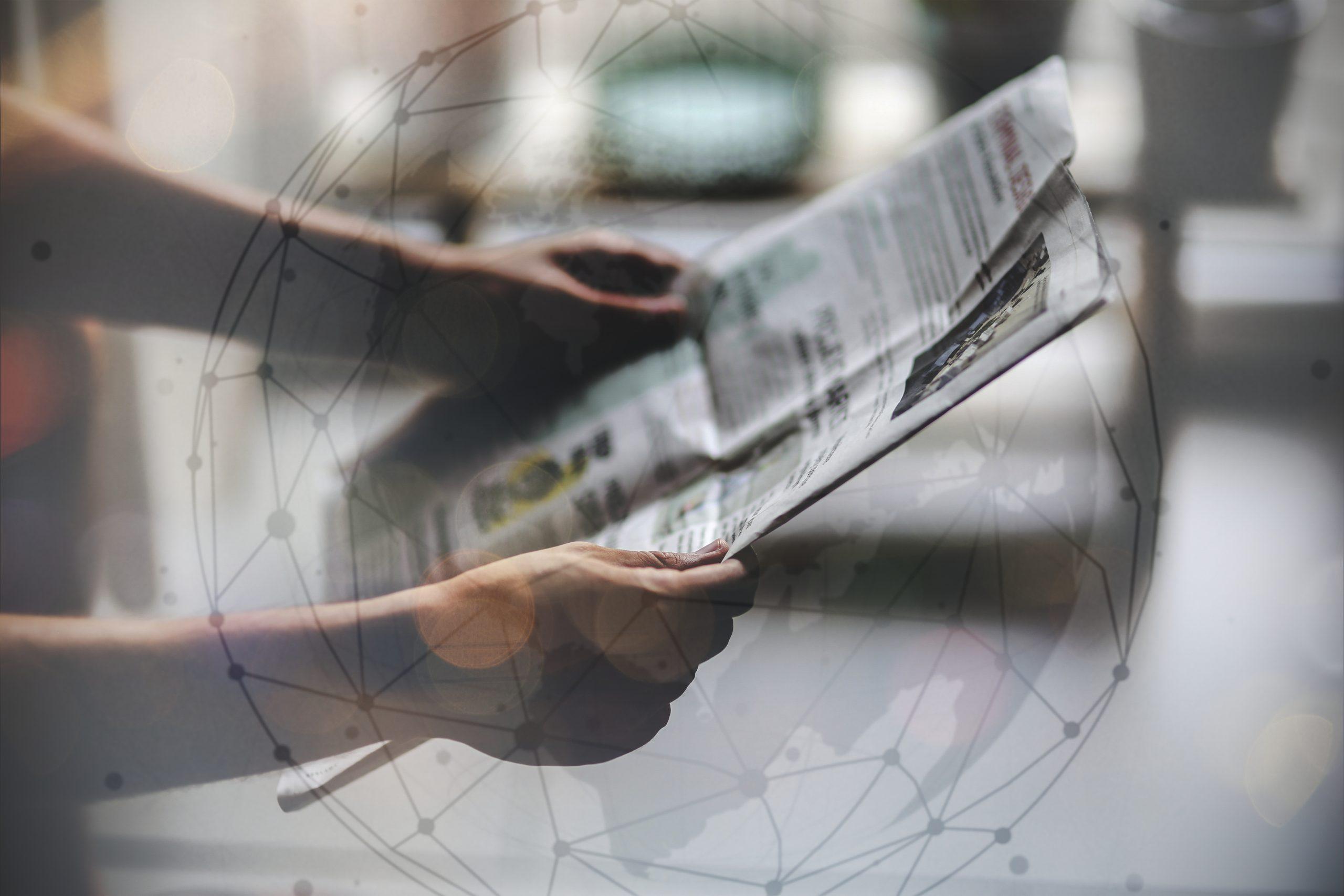 man-reading-newspaper